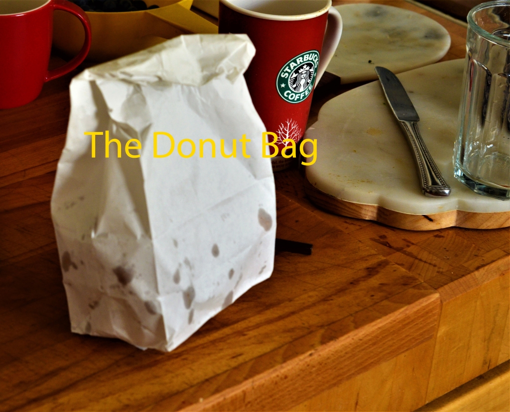 This image has an empty alt attribute; its file name is the-donut-bag.jpg